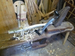 handle in shave horse with drawknife