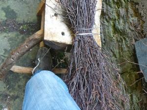 Twigs held in rope sling