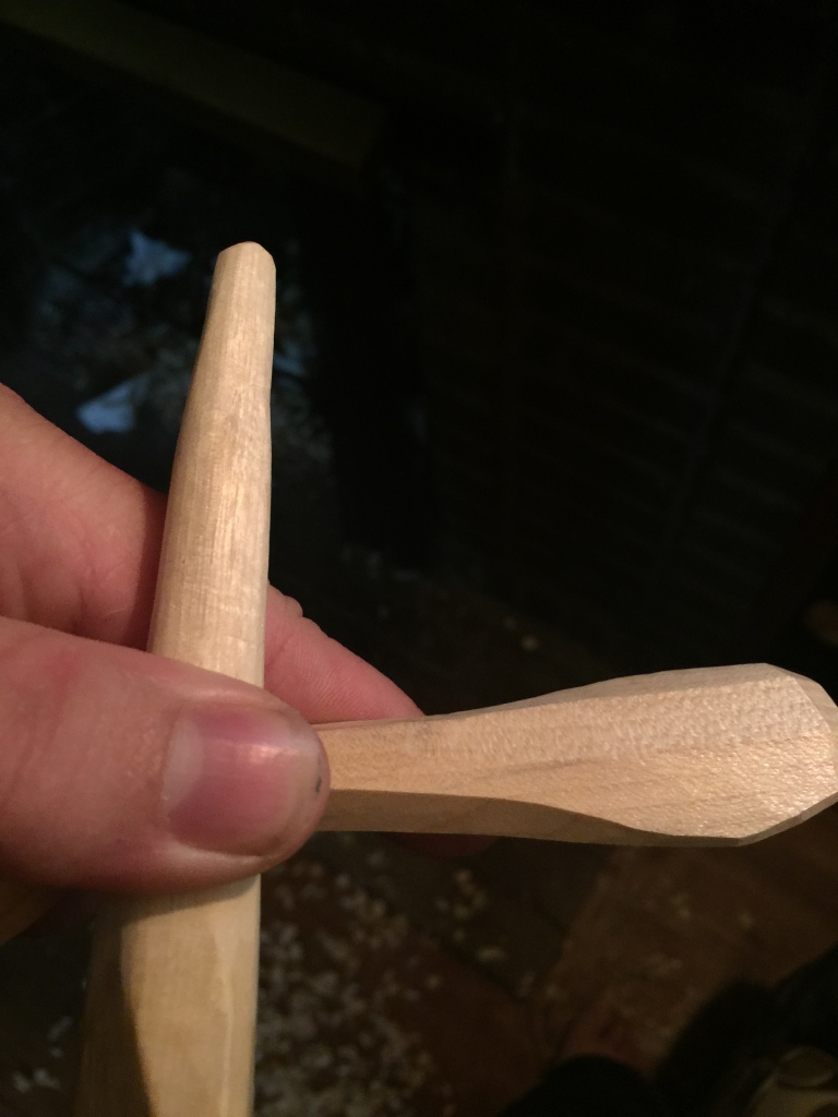 Burnishing stick along the spoon's handle